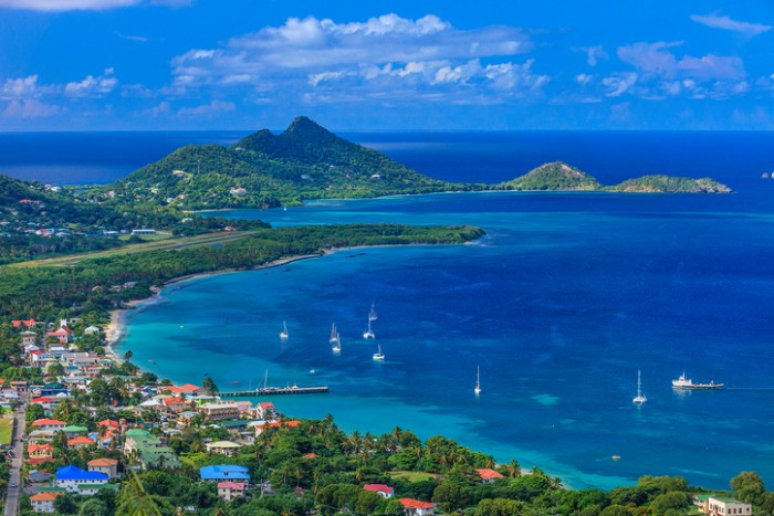 From the hill of Belair, the site of the Carriacou hospital, you can have a breathtaking view of the town of Hillsborough and its beautiful bay. Some old rusty cannons are pointed on the bay. Carriacou, Grenada W.I.