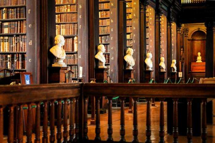 Dublin, Eire - November 17, 2013: Thousands of books on shelves inside the Trinity College Library Dublin, Part of the University of Dublin