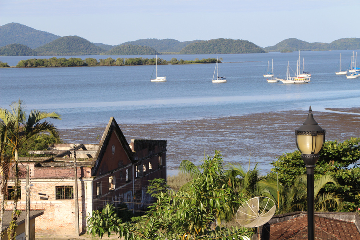 This is a photo from Antonina, Paran?, Brazil overlooking the bay adjacent to this town.  In the bay are sailboats and on the shore are the ruins of a century old warehose.  The photo was taken in June 2015 from the parking lot of a local Catholic church on a hill overlooking the bay.
