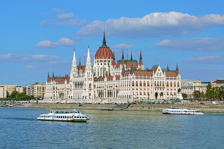 Hungarian Parliament Building and two sightseeing ships on the Danube in Budapest, Hungary