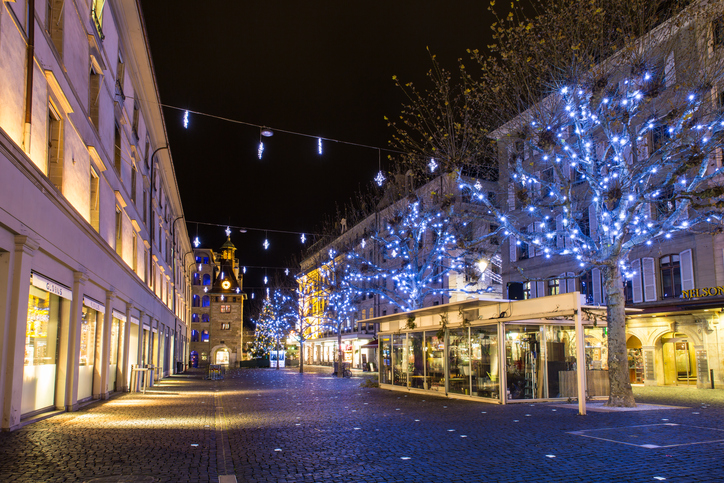 Geneva, Switzerland - December 13, 2014: The Molard square at night illuminated by Christmas decorations, in downtown Geneva.
