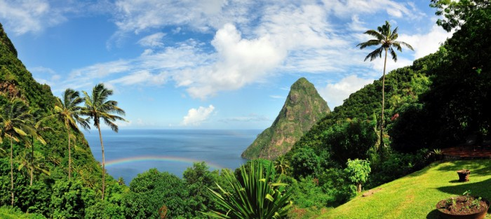 Pool, palm trees and rainbow over the bay by the Pitons  in the Caribbean tropical island of Saint Lucia