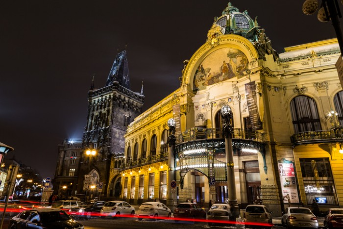 Prague, Czech Republic - January 6, 2016:  The Powder Tower and Municipal House in Prague at Night in the Winter. Cars and Traffic can be seen.