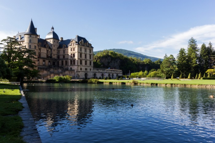 Vizille, Auvergne-Rhône-Alpes, France - August 14, 2015: Castle in Vizille in France during a sunny day. It is one of the most prestigious and important castles of the Dauphiné Region. The castle park has a total of 320 acres of space and was classified as a historic monument.