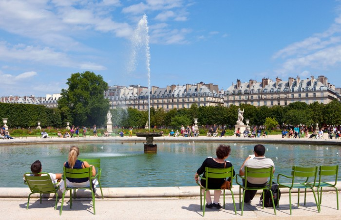 Paris, France - August 4, 2014: People relaxing around a fountain in the beautiful Jardin des Tuileries in Paris on the 4th August 2014.