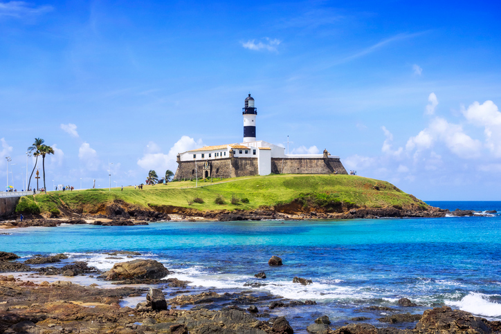 View of Farol da Barra Lighthouse in Salvador da Bahia, Brazil. Dating from the year 1698, it is said to be the oldest lighthouse in South America.