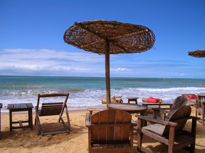 A view of Trancoso Beach, nearby Porto Seguro, Bahia, Brazil, South America. At the background ths blue sky can be seen, just above the green sea.