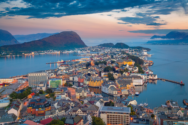 Cityscape image of Alesund, Norway at dawn.
