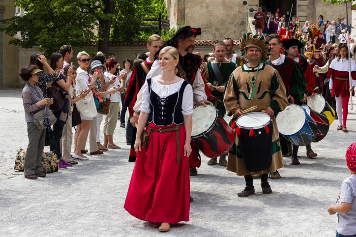 Cesky Krumlov, Czech republic - June 22, 2014: People dressed in historical costumes are walking in Krumlov streets during annual Five-petalled Rose Celebrations. The spectacular procession begins from Krumlov castle.