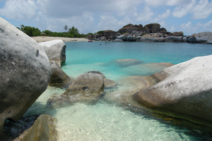 Boulders, beach and turquoise waters