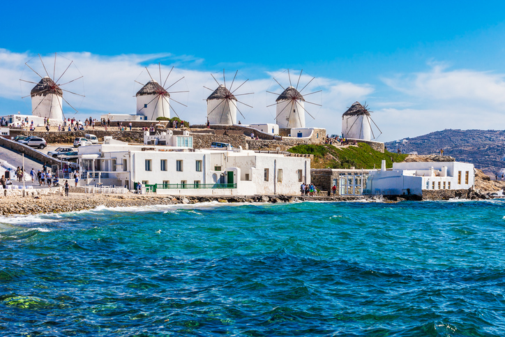 Two of the famous windmills in Mykonos, Greece during a clear and bright summer sunny day