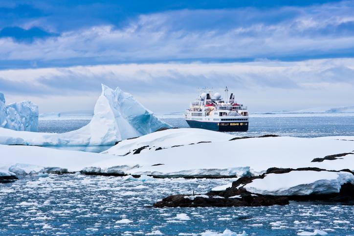 Big cruise ship in the Antarctic watersBig cruise ship in the Antarctic watersBig cruise ship in Antarctic waters
