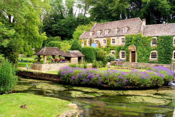 Picturesque garden in the Cotswold village of Bibury, England