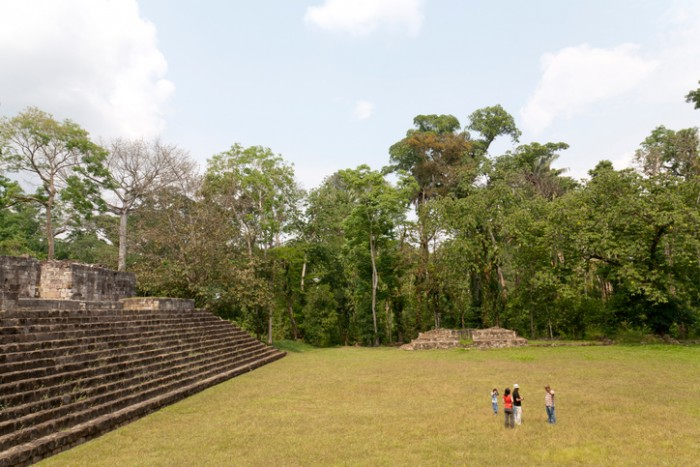 Izabal, Guatemala - April 22, 2011: Tourists listen to the guide at Quirigua national park in Guatemala.