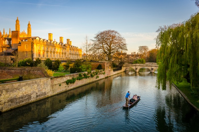 Cambridge, UK - April 21, 2015: Evening punting on the River Cam in Cambridge