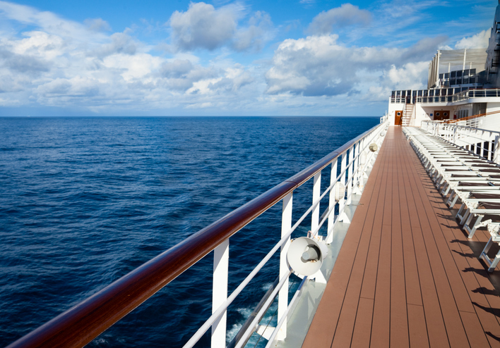 Walking along the deck of a cruise ship at sea