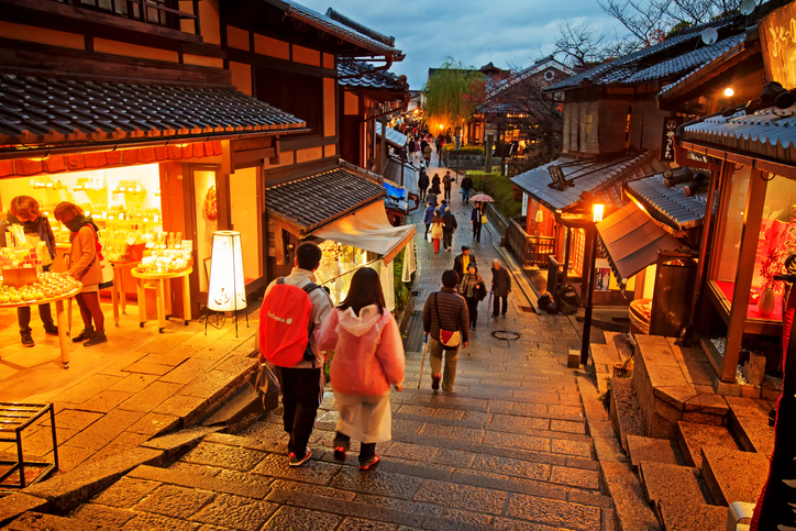 KYOTO, JAPAN - November 25 2013: Tourists walk on a street leading to Kiyomizu Temple on November 25 2013 for Sakura viewing. Kiyomizu is a famous temple in Kyoto built in year 778