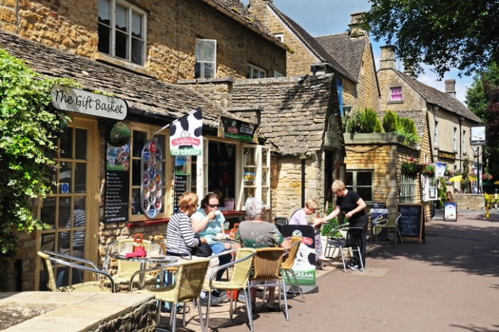 Bourton on the Water, United Kingdom - June 12, 2014:  Women relaxing at a pavement cafe with waitress service, Bourton on the Water, Gloucestershire, England, UK, Western Europe.