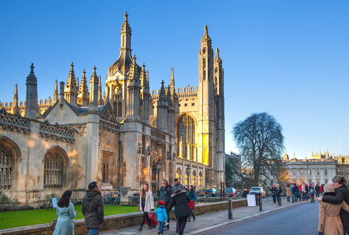 Cambridge, UK - January 18, 2015: King's college view. Main entrance gate and King's chapel. Collage was started in 1446 by Henry VI.