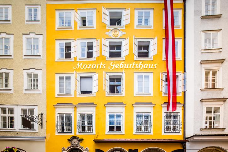 Wolfgang Amadeus Mozart's Birthplace - the house where Mozart was born  - Mozarts Geburtshaus with Austrian Flag in the famous Getreidegasse 9, old town street in Salzburg, Austria