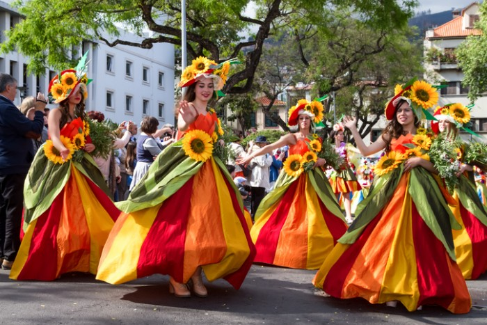 Funchal, Madeira, Portugal - April 19, 2015: Dancers perform during of Flower parade at the Madeira Island, Portugal. The Madeira Flower Festival is an annual event.