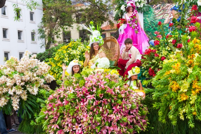 Funchal, Madeira, Portugal - April 19, 2015: Participants in festive Parade Float at the Madeira Flower Festival, Funchal, Madeira, Portugal