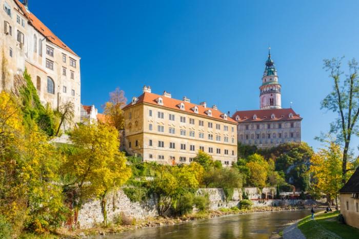 Cesky Krumlov, Czech republic - October 12, 2014: Castle tower in Cesky Krumlov, Czech republic. Sunny autumn day. UNESCO World Heritage Site