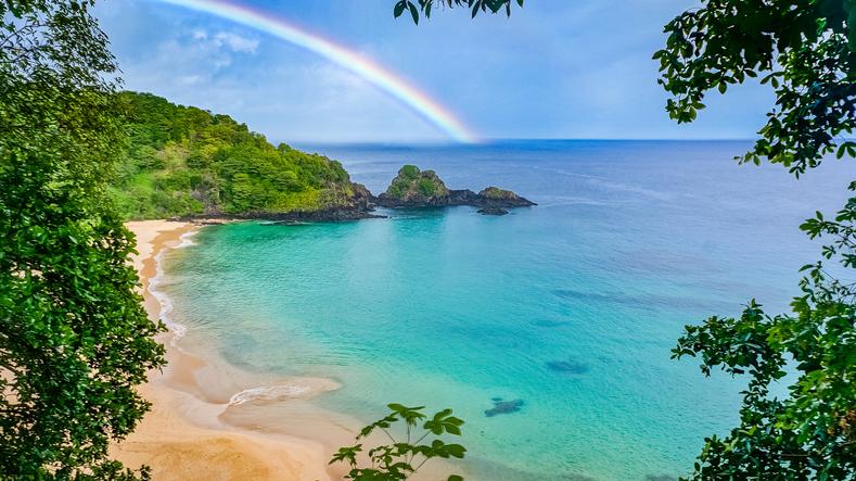 Rainbow in Praia do Sancho beach, Fernando de Noronha, Brazil