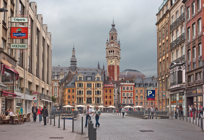 Lille, France - July 15, 2014: Street leading to Vieille Bourse on the Grand Place with people walking and sightseeing