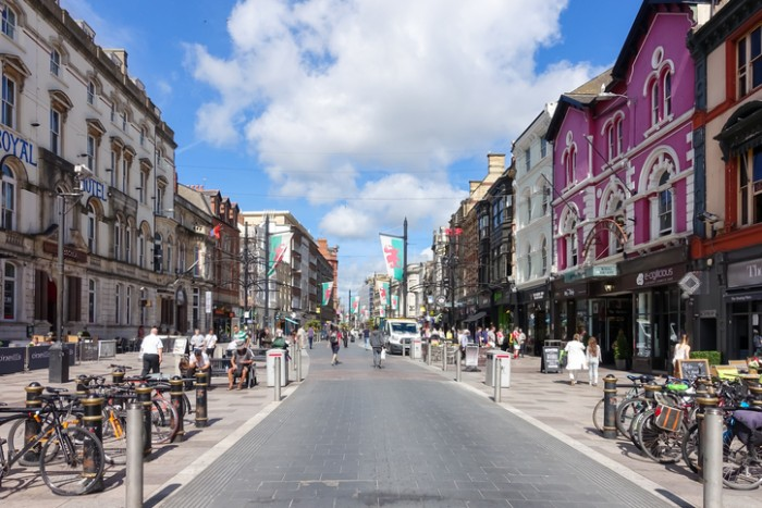 Cardiff, United Kingdom, Wales - August 26, 2016: Tourists and locals going shopping in St Mary Street, Cardiff, on a Friday morning. The road is the home of a number of shops, bars, night clubs and restaurants as well as branches of many major banks.