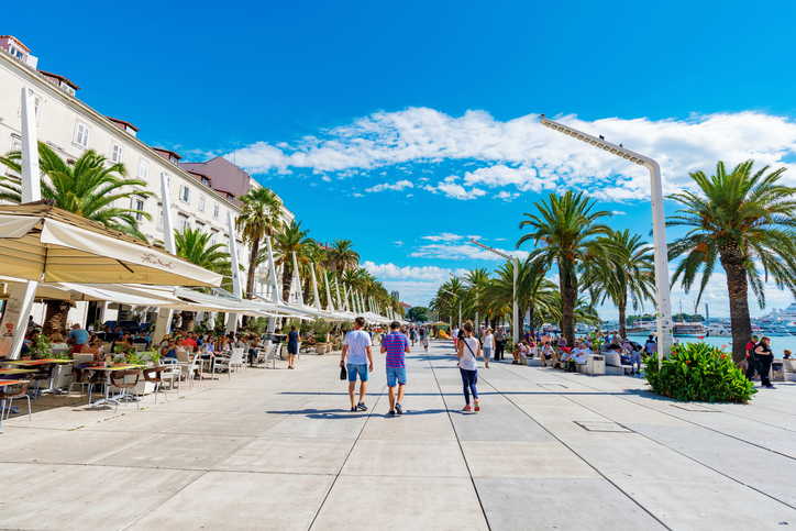 Split, Croatia - September 17, 2016: Seafront promenade area in Split old town with restaurants and cafes on a sunny day