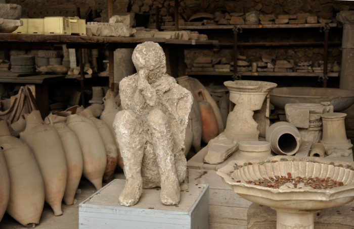 A victim of Vesuvio eruption on 79 AD. The statue is preserved in Pompeii along with many other finds.