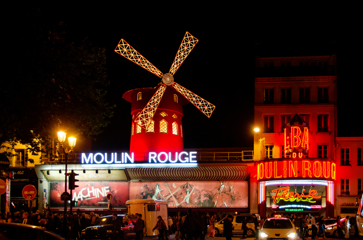 Paris, France - April 30: The Moulin Rouge by night, on April 30, 2014 in Paris, France. Moulin Rouge is a famous cabaret built in 1889, locating in the Paris red-light district of Pigalle