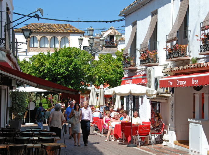 Marbella, Spain - June 11, 2008: Pavement cafes on the edge of the Orange Square (Plaza de los Naranjos) with tourists enjoying the setting, Marbella, Costa del Sol, Malaga Province, Andalusia, Spain, Western Europe.