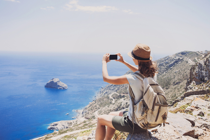 Young girl making a picture, travel concept
