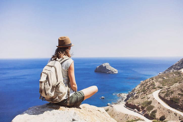 Young woman traveler on vacations, travel and active lifestyle concept