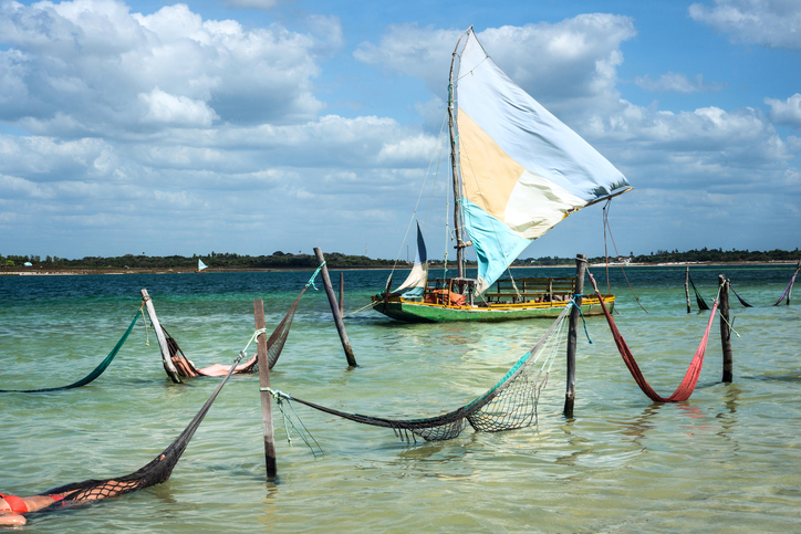 Sail boat and hammocks at the Paradise Lake (Jericoacoara, Brazil)