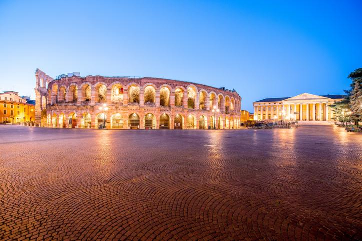 Night view on illuminated Arena on Bra square in Verona city