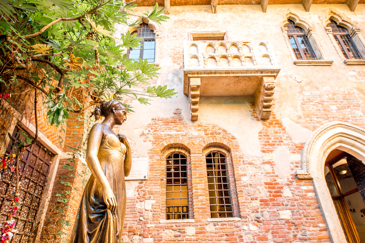 Verona, Italy - May 22, 2016: Juliet statue and balcony in Verona. Romeo and Juliet is a tragedy written by William Shakespeare. This place is the main tourist attraction in Verona.