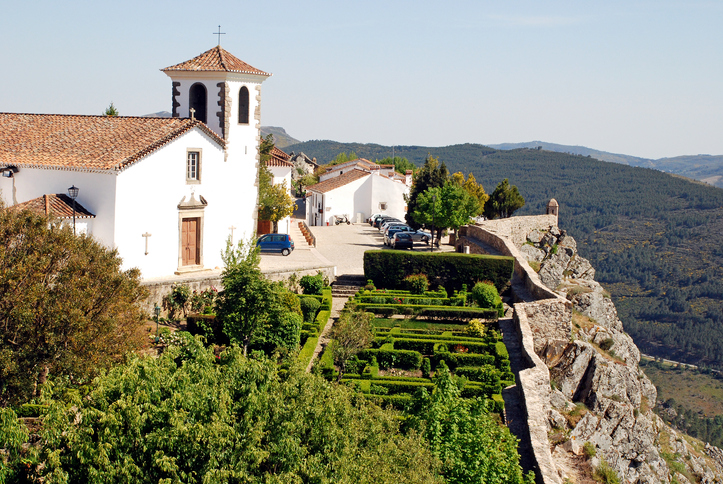 white cathedral and ornamental garden in medieval village Marvao (13th century) on the serra of Alto Alentejo (Portugal) .
