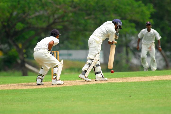 A cricket batsman ready to bat.