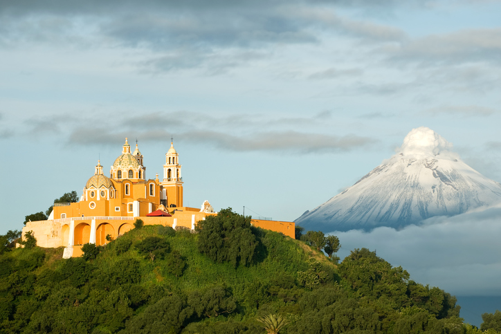 View of Popocatepetl volcano, with the church of Nuestra Se?ora de los Remedios at the front. City of Cholula, Mexico.
