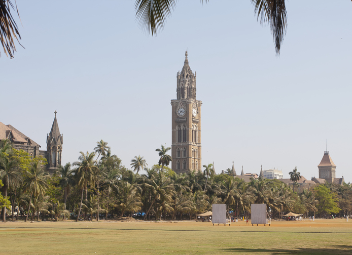 """""""The Rajabai Clock Tower (center) stands in south Mumbai, India, and is one of the landmarks of the city. Built in Gothic style in 1878, it was funded by a properous broker on condition that it be named after his mother Rajabai."""""""