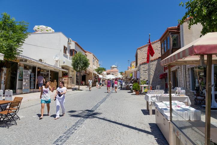 Alacati, Turkey - June 22, 2013: Ugur Mumcu pedestrian street in Alacati. Alacatı is an Aegean town on the western coast of İzmir Province in Turkey.