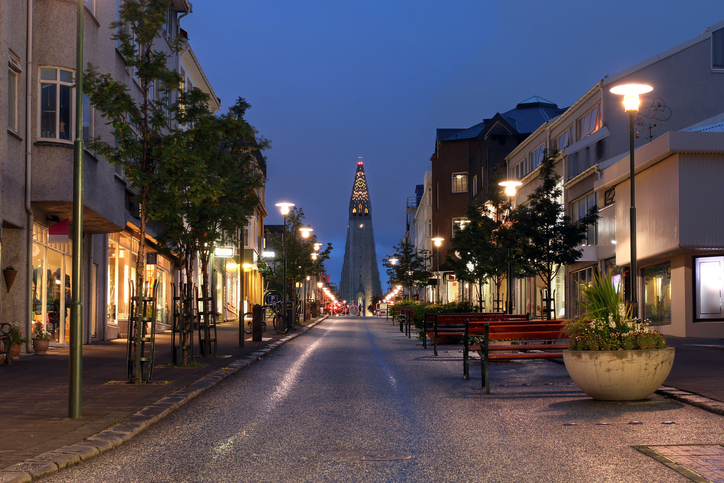 Night view of Skolavordustigur street leading to the Hallgrimskirkja Church, one of the landmarks of Reykjavik, the capital city of Iceland.