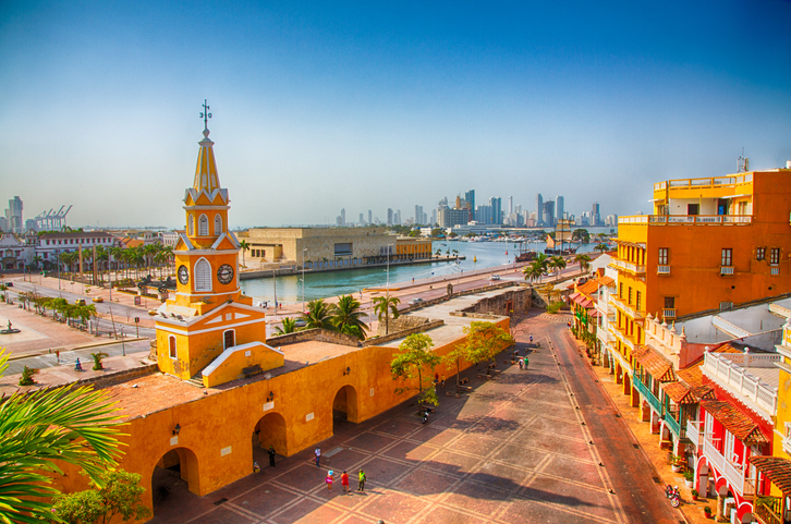 Cartagena, Colombia - February 23, 2014: Workers start their day near the Clock Tower Gate in Cartagena's old city.