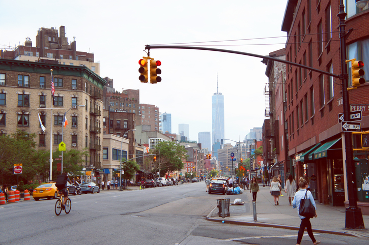 New York, United States - June 9, 2015: People walking down the 7th Avenue South street in cloudy summer morning in the New York City.