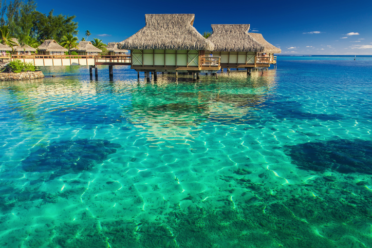 Villas in the lagoon with steps into shallow clean water with coral