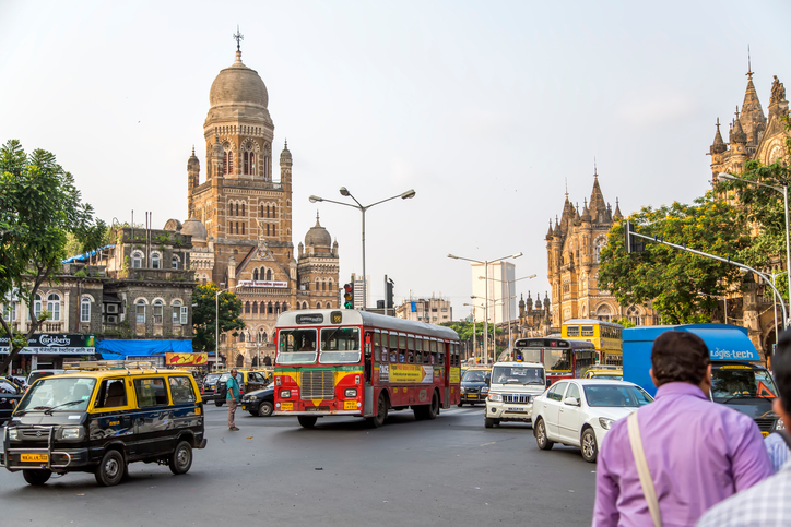 Mumbai, India - October 9, 2015: Unidentified people by the Municipal Corporation Building in Mumbai, India. This gothic building was completed at 1893 and since 2005 is a Grade IIA heritage building.