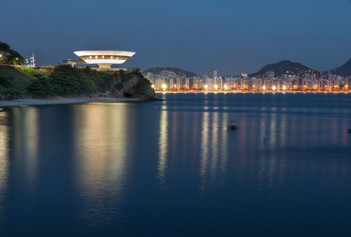 Niteroi, Brazil - January 11, 2015: Night photograph of the Museum of Contemporary art in Niteroi and Icarai beach on the background
